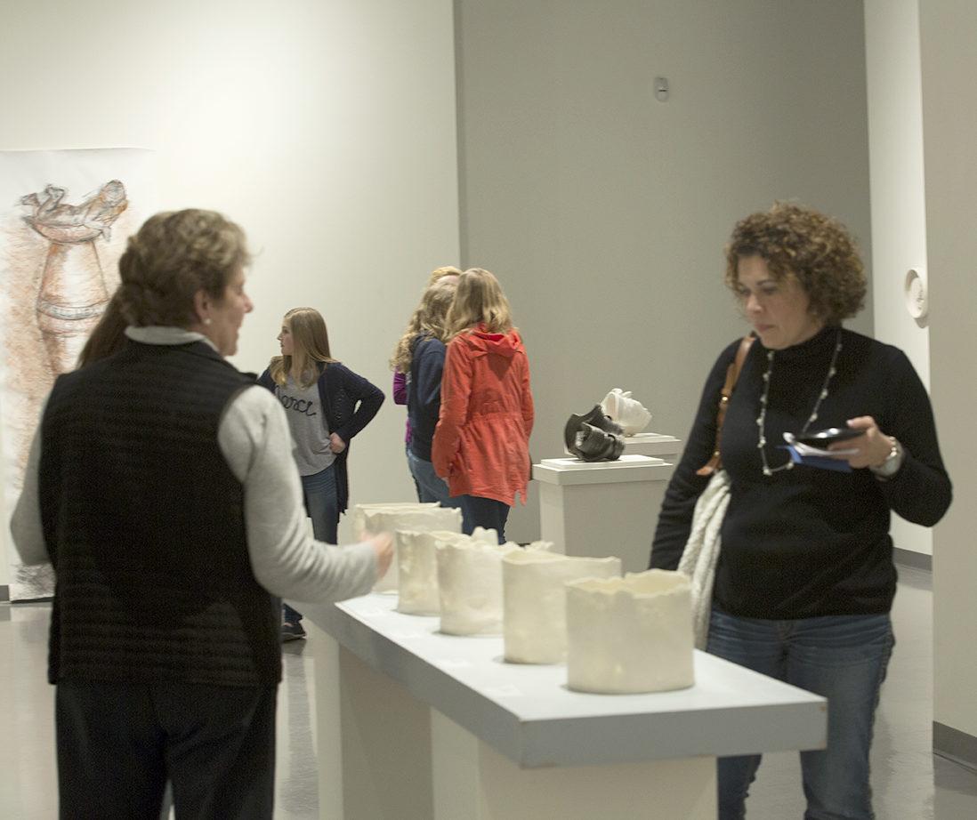 Spartanburg residents walking around a museum during ArtWalk.
