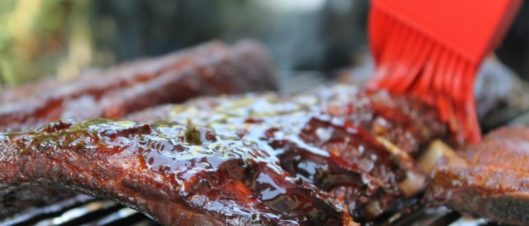 Ribs being cooked on the grill.