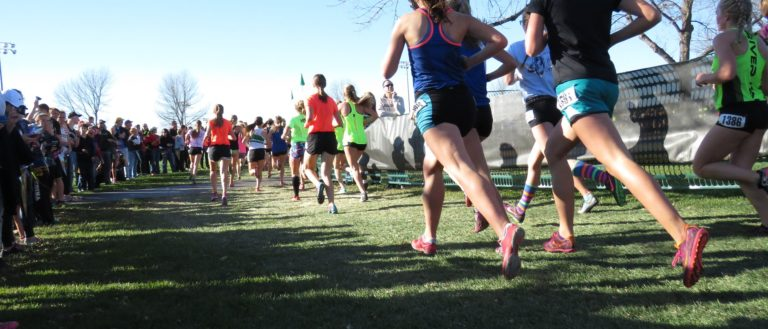Runners approaching the finish line of a 5K.