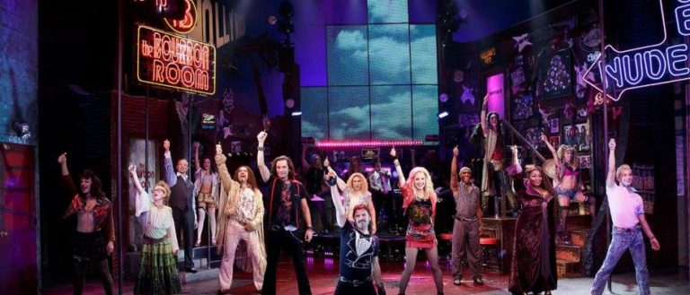 Performances of Rock of Ages on stage at Chapman Cultural Center.