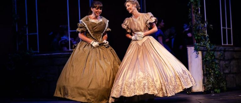 Actresses on stage in The Logos Theatre's production of Little Women.