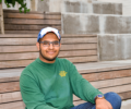 Wofford student Nathan Patnam sitting on wooden steps.