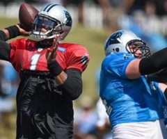 Cam Newton in the pocket throwing a pass at training camp.