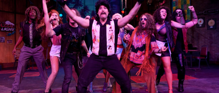 Performers of Rock of Ages on stage at Chapman Cultural Center