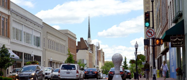 A sidewalk-level view of downtown Spartanburg's Main Street.