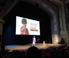 A speaker on stage during Healthy Laughter Spartanburg.