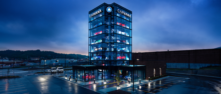 """A Carvana retail location featuring a large """"vending machine."""""""