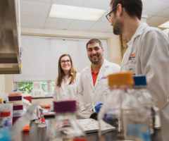 Mark Blenner (center) works in his lab with students Lexie Adams (left) and Will Burnette.